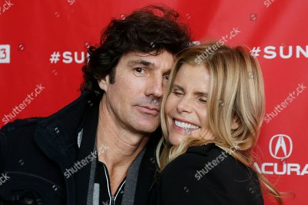 """Cast members, actress Mariel Hemingway, right, and her boyfriend Bobby Williams, left, pose together at the premiere of """"Running From Crazy"""" during the 2013 Sundance Film Festival on in Park City, Utah"""
