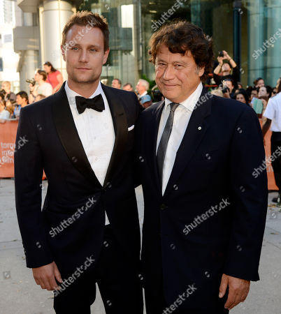 """Ari Lantos, left, and Robert Lantos, producers of """"The Right Kind of Wrong,"""" pose together at the premiere of the film on day 8 of the 2013 Toronto International Film Festival at Roy Thomson Hall on in Toronto"""