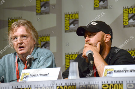 """Screenwriter Michael Hirst, left, and Travis Fimmel attend the """"Vikings"""" panel on Day 2 of Comic-Con International, in San Diego"""