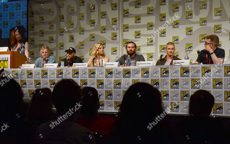 """Kate Hahn, and from left, screenwriter Michael Hirst, Travis Fimmel, Katheryn Winnick, Clive Standen, Alexander Ludwig and producer Julian Hobbs attend the """"Vikings"""" panel on Day 2 of Comic-Con International, in San Diego"""