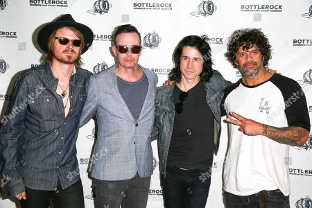 Nick Maybury, from left, Scott Weiland, Tommy Black and Dan Thompson of Scott Weiland And The Wildabouts pose for a photo at the 2015 BottleRock Napa Valley Music Festival at the Napa Valley Expo, in Napa, Calif
