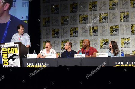 """Moderator Jon Hein, from left, Hugh Davidson, Larry Dorf, Mike Tyson and Rachel Ramras attend the """"Mike Tyson Mysteries"""" panel on day 2 of Comic-Con International, in San Diego, Calif"""