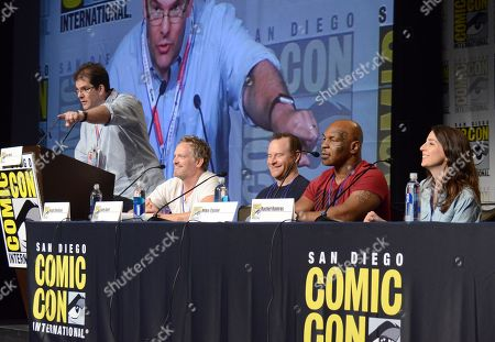 """Moderater Jon Hein, from left, Hugh Davidson, Larry Dorf, Mike Tyson and Rachel Ramras attend the """"Mike Tyson Mysteries"""" panel on day 2 of Comic-Con International, in San Diego, Calif"""