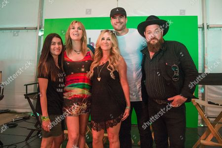 Stock Image of Leilani Munter, from left, Grace Potter, Lee Ann Womack, Sam Hunt, and Nathaniel Ratliff pose at Bonnaroo Music and Arts Festival, in Manchester, Tenn
