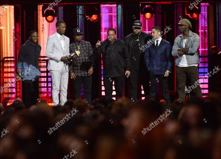 Stock Picture of Kendrick Lamar, from left, Corey Hawkins, Jason Mitchell, DJ Yella, O'Shea Jackson Jr., Neil Brown Jr., and Aldis Hodge accept the True Story award for 'Straight Outta Compton' at the MTV Movie Awards at Warner Bros. Studio, in Burbank, Calif