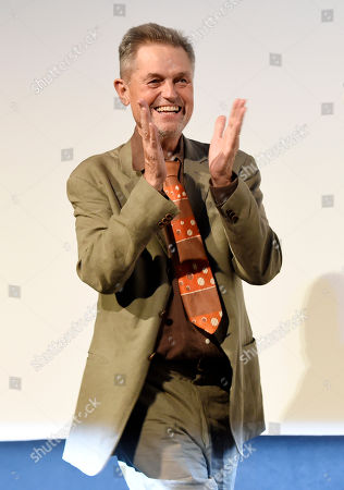 """Jonathan Demme, director of the concert film """"Justin Timberlake + The Tennessee Kids,"""" is introduced onstage at the premiere of the film on day 6 of the Toronto International Film Festival at Roy Thomson Hall, in Toronto"""
