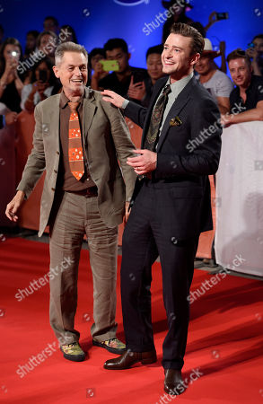 """Jonathan Demme, left, director of the concert film """"Justin Timberlake + The Tennessee Kids,"""" and star Justin Timberlake mingle at the premiere of the film on day 6 of the Toronto International Film Festival at Roy Thomson Hall, in Toronto"""