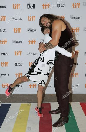 Ana Lily Amirpour, left, and Jason Momoa attend The Bad Batch premiere on day 6 of the Toronto International Film Festival at the Ryerson Theatre, in Toronto