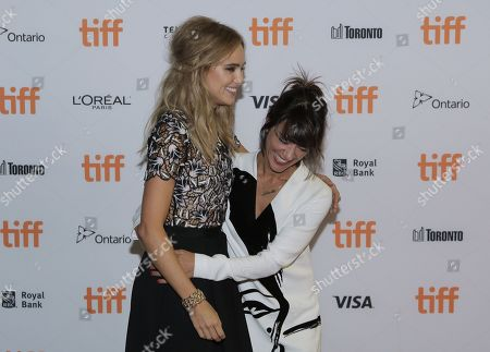 Suki Waterhouse, left, and Ana Lily Amirpour attend The Bad Batch premiere on day 6 of the Toronto International Film Festival at the Ryerson Theatre, in Toronto