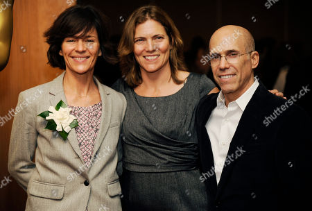 "Kristine Belson, left, and Jane Hartwell, producers of the Oscar-nominated animated feature film ""The Croods,"" pose with DreamWorks Animation CEO Jeffrey Katzenberg at a reception featuring the Oscar nominees in the Animated Feature Film category, in Beverly Hills, Calif. The 86th Oscars ceremony will be held on Sunday at the Dolby Theatre in Los Angeles"