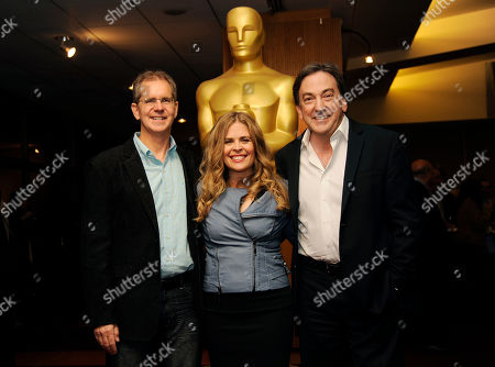 "Chris Buck, left, and Jennifer Lee, center, co-directors of the Oscar-nominated animated feature film ""Frozen,"" pose with producer Peter Del Vecho at a reception featuring the Oscar nominees in the Animated Feature Film category, in Beverly Hills, Calif. The 86th Oscars ceremony will be held on Sunday at the Dolby Theatre in Los Angeles"
