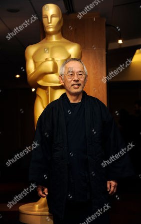 "Toshio Suzuki, producer of the Oscar-nominated animated feature film ""The Wind Rises,"" poses at a reception featuring the Oscar nominees in the Animated Feature Film category, in Beverly Hills, Calif. The 86th Oscars ceremony will be held on Sunday at the Dolby Theatre in Los Angeles"