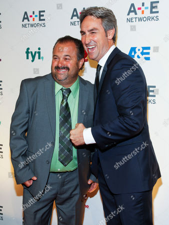 Frank Fritz, left, and Mike Wolfe, right, attend the A+E Networks 2015 Upfront at the Park Avenue Armory, in New York