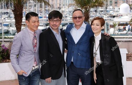 From left, actor Andy Lau, actor Wai Ka-fai, director Johnnie To and actress Sammi Cheng pose for photographers during a photo call for the film Blind Detective at the 66th international film festival, in Cannes, southern France
