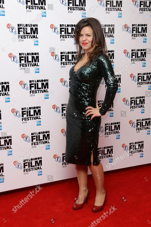 Director Corinna McFarlane poses for photographers upon arrival at the premiere of the film Silent Storm, in London