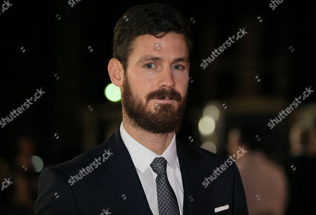 Actor Henry Garrett poses for photographers on arrival at the premiere of the film Testament of Youth in central London on