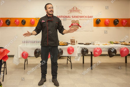 Stock Picture of Chef Fabio Viviani demonstrates making sandwiches during the Brownberry Bread National Sandwich Day Event at The Boys & Girls Jordan Club on in Chicago