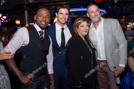 """Romany Malco, from left, Robbie Amell, Terry Press and Mark Ross arrive at the Los Angeles Fan Screening of """"THE DUFF"""", in Los Angeles"""