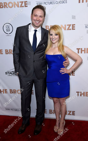 """Winston Rauch and his wife Melissa Rauch, co-writers of """"The Bronze,"""" pose together at the premiere of the film """"The Bronze"""" at the Pacific Design Center, in West Hollywood, Calif"""