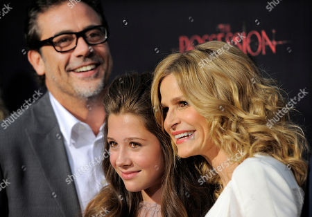 """Kyra Sedgwick, right, a cast member in """"The Possession,"""" poses with fellow cast members Natasha Calis, center, and Jeffrey Dean Morgan at the premiere of the film at Arclight Cinemas, in Los Angeles"""