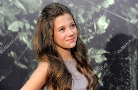 """Natasha Calis, a cast member in """"The Possession,"""" poses at the premiere of the film at Arclight Cinemas, in Los Angeles"""