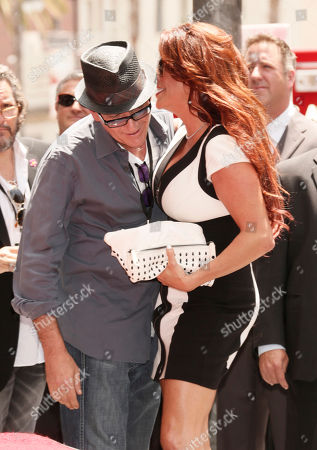 Actor Charlie Sheen and Perla Ferrar attend the 2,473rd star on the Hollywood Walk of Fame for musician Slash outside the Hard Rock Cafe on in Hollywood, California
