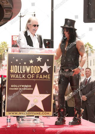 DJ Jim Ladd introduces Slash at a the Hollywood Walk of Fame Ceremony for Slash on in Los Angeles, CA