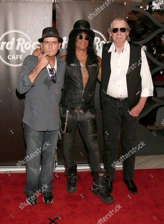 Charlie Sheen, Slash and DJ Jim Ladd pose at a the Hollywood Walk of Fame Ceremony for Slash on in Los Angeles, CA