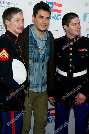 Aaron, Mankin, left, John Mayer and Michael Martinez arrive at the 6th Annual Stand Up For Heroes benefit concert for injured service members and veterans on in New York