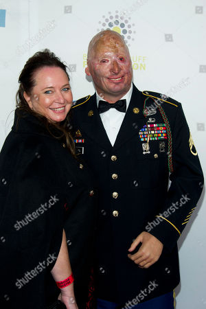 Stock Photo of Staff Sgt. Robert Henline U.S. Army and wife Connie arrive at the 6th Annual Stand Up For Heroes benefit concert for injured service members and veterans on in New York