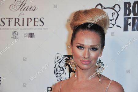 Katarina Van Derham attends Stars for Stripes at Hemingway's and Roxbury, in Los Angeles