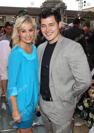 Jessica Collins, left, and Christopher Sean attend the Television Academy's 67th Emmy Performance Peer Group Celebration at the Montage Beverly Hills on in Beverly Hills, Calif