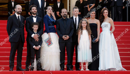 From left, actors Ali Mosaffa, Tahar Rahim, Elyes Aguis, Berenice Bejo, director Asghar Farhadi, producer Alexandre Mallet-Guy, actors Jeanne Jestin, Sabrina Ouazani and Pauline Burlet arrive for the screening of film The Past at the 66th international film festival, in Cannes, southern France