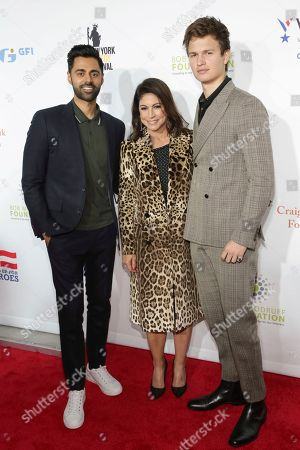Hasan Minhaj, Caroline Hirsch, Ansel Elgort. Comedian Hasan Minhaj, from left, Caroline Hirsch, and actor Ansel Elgort attend the 11th Annual Stand Up for Heroes benefit, presented by the New York Comedy Festival and The Bob Woodruff Foundation, at the Theater at Madison Square Garden, in New York