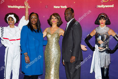 Pat Houston, right, and Gary Houston unveil Whitney Houston wax figures at Madame Tussauds in New York on