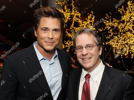 """Actor Rob Lowe, left, and National Economic Council Director Gene Sperling attend the National Geographic Channel's """"Killing Kennedy"""" world premiere screening reception at The Newseum, in Washington"""