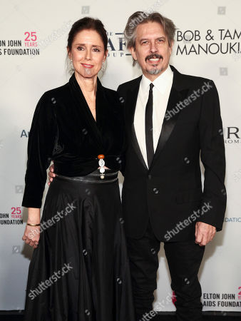 Julie Taymor, Elliot Goldenthal. Julie Taymor, left, and Elliot Goldenthal, right, attend the Elton John AIDS Foundation's 25th Anniversary Gala at The Cathedral of St. John the Divine, in New York