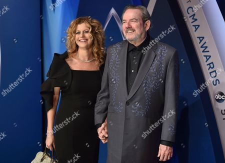 Stock Photo of Laura Savini, Jimmy Webb. Laura Savini, left, and Jimmy Webb arrive at the 51st annual CMA Awards, in Nashville, Tenn