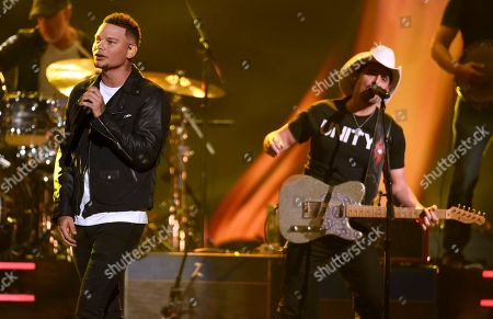 "Brad Paisley, Kane Brown. Brad Paisley, right, and Kane Brown perform ""Heaven South"" at the 51st annual CMA Awards at the Bridgestone Arena, in Nashville, Tenn"