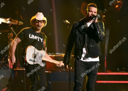 "Brad Paisley, Kane Brown. Brad Paisley, left, and Kane Brown perform ""Heaven South"" at the 51st annual CMA Awards at the Bridgestone Arena, in Nashville, Tenn"
