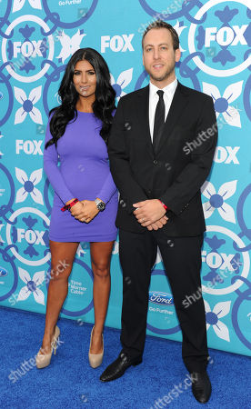 Stock Image of MasterChef finalists Natasha Cmjac and Luca Manfe arrive at the 2013 FOX Fall Eco-Casino Party, on in Santa Monica, Calif
