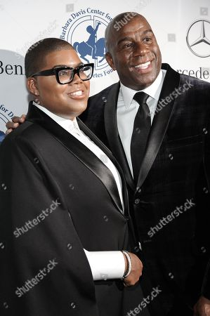 """EJ Johnson, left, and Earvin """"Magic"""" Johnson arrive at the 2014 Carousel Of Hope Ball, in Beverly Hills, Calif"""