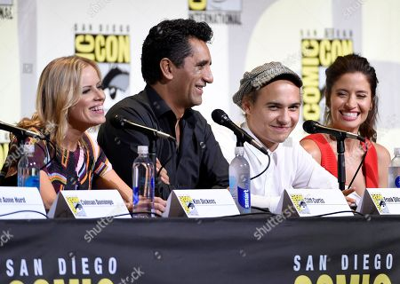 "Kim Dickens, from left, Cliff Curtis, Frank Dillane, and Mercedes Mason attend the ""Fear the Walking Dead"" panel on day 2 of Comic-Con International, in San Diego"