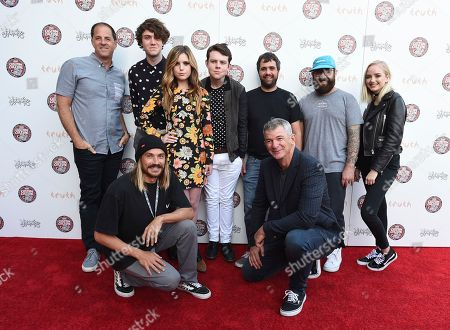 Doug Palladini, Vans general manager, North America, from left, Noah Sierota, Sydney Sierota, Graham Sierota, Jon Shook, Vinny Dotolo, Maddi Bragg, Dylan Graves, bottom left and Kevin Bailey, Vans president, bottom right, attend the 2016 Vans Custom Culture design competition event in Los Angeles on