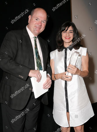 Larry Miller and 2014 IFF Cinematic Achievement Award Winner Dana Ivgy attends the Opening Night Gala for the 28th Israel Film Festival at the Saban Theatreon in Beverly Hills, Calif