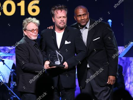 Stock Photo of Paul Williams, ASCAP president and chairman, from left, Founder award winner John Mellencamp and Tavis Smiley pose on stage at the 33rd annual ASCAP Pop Music Awards at the Dolby Ballroom, in Los Angeles