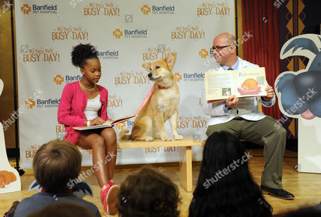 Quvenzhane Wallis, star of the upcoming musical film Annie, her four-legged co-star Sandy and Dr. Ari Zabell, of Banfield Pet Hospital, read aloud from Banfield's first-ever children's book, My Very, Very Busy Day, at a book launch event at the Children's Museum of Manhattan, in New York. Banfield's children's book, from which all proceeds will be used to provide preventive care to pets in need, is written to entertain and educate children on what it means to be a responsible pet owner and the importance of pets receiving preventive veterinary care; for more information visit, www.banfield.com/myveryverybusyday