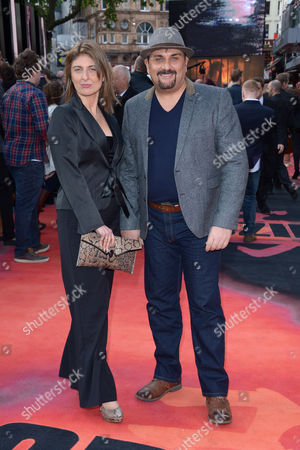 Mem Ferda, right, and guest pose for photographers on the red carpet for the UK premiere of Godzilla in London on