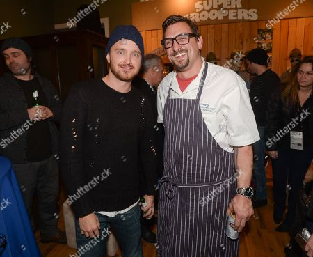 "Actor Aaron Paul, left, and chef Chris Cosentino at the Chase Sapphire Preferred ""Hellion"" premiere party during the Sundance Film Festival, on in Park City, Utah"