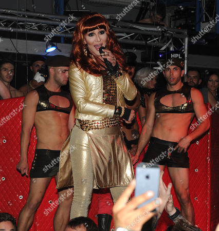 Cher impersonator Chad Michaels performs during Cher's appearance at Ultra Suede in West Hollywood, California on . Cher has her eight number one single with her new song 'Woman's World' on the Billboard Hot Dance Club Songs chart